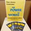 Informational brouchures rest on a table beside a display of 40 of the top 100 most banned books on Thursday at MSSU's George A. Spiva Library.<br /> Globe | Laurie Sisk