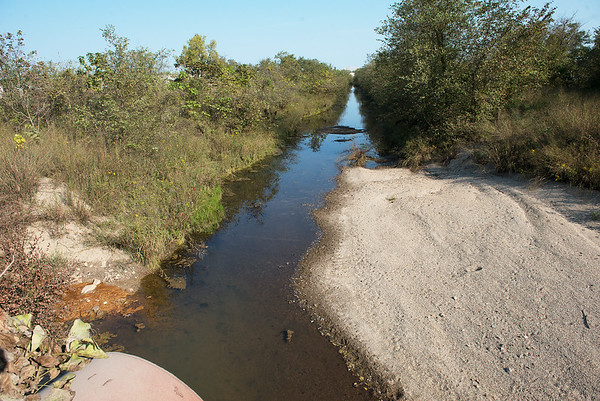Globe/Roger Nomer<br /> On one side of East 40 Road in Douthat, Tar Creek runs clear.