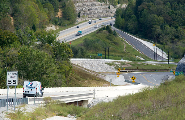 Upper left: Traffic moves north on Hwy 71 near the planned exit to the I-49 bypass in Bentonville on Thursday.<br /> Globe | Lurie Sisk