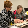 Globe/Roger Nomer<br /> Denise Bertoncino, program coordinator for the interior design, helps Megan Gray, a Pittsburg State junior from Girard, Kan., with a perspective project on Monday at Pittsburg State's Kansas Technology Center.