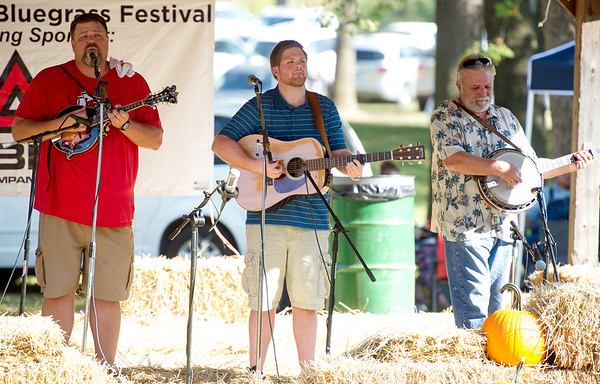 Members of the bluegrass band Kentucky 31 entertain the crowd Saturday afternoon during the Carl Junction Bluegrass Festival on Saturday at Center Creek Park.<br /> Globe | Laurie Sisk