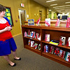 Missouri Southern Access Services Librarian Kayla Reed stands beside a display she organized of 40 0f the top 100 most banned books on Thursday at MSSU's George A. Spiva Library.<br /> Globe | Laurie Sisk