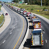 Globe/Roger Nomer<br /> A processional of firetrucks travel to Carl Junction Cemetery along Main Street on Friday.