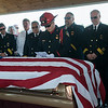 Globe/Roger Nomer<br /> Joplin Driver Justin Slates leads a tribute to former Carl Junction Fire Chief Bill Dunn on Friday at Carl Junction Cemetery.