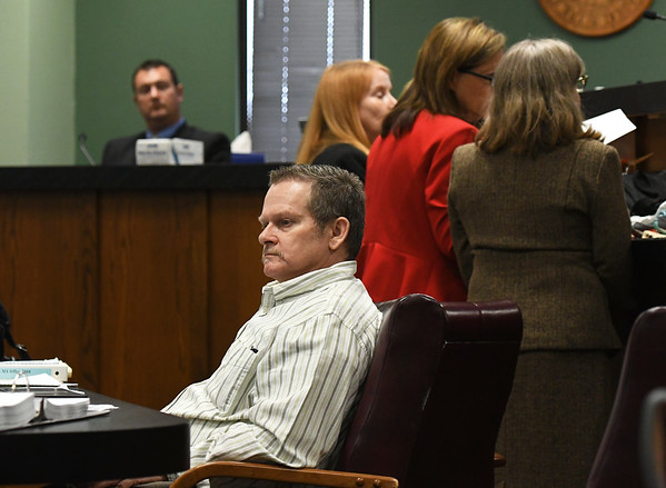Todd Greathouse, center, sits in his chair during a sidebar on Tuesday at the Jasper County Circuit Court. Great house is on trial for the first-degree murder of 61-year-old Willanna Dunn.<br /> Globe | Laurie Sisk