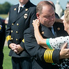 Globe/Roger Nomer<br /> Joplin Fire Chief Jim Furgerson talks with Ruby Dunn during the ceremony for her husband Bill on Friday at Carl Junction Cemetery.