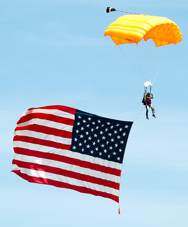 "Hoyt Perry, of Skydive Fayetteville,  escorts a large American flag during the playing of ""The Star Spangled Banner"" to open  Alpha AirFest 2017 on Saturday at the Joplin Regional Airport. The show continues today with a full slate of activities from 10 a.m. to 5 p.m.<br /> Globe 