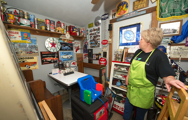 Owner Marsha Hill stands near a single booth sits inside the seldom used Man Cave - one of several themed rooms at Maggie Mae's Tea Room.<br /> Globe | Laurie Sisk
