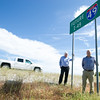From the left: Jeff Hawkins, executive director of the Northwest Arkansas Regional Planning Commission and Tim Conklin, transportation program manager for NWARPC, stand Thursday by a sign on the I-49 Bypass project in Bentonville.<br /> Globe | Laurie Sisk
