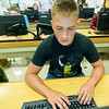 Miller High School sophomore Neilson Hadlock works on a computer during computer apps class on Wednesday at MHS. Hadlock said the four-day schedule allows students to more easily work a part time job and allows more time to catch up on chores at home.<br /> Globe | Laurie Sisk