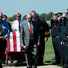 Globe/Roger Nomer<br /> Firefighters from around the region salute on Friday as former Carl Junction Fire Chief Bill Dunn's casket is brought into Carl Junction Cemetery.