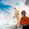 Globe/Roger Nomer<br /> Lilly Williams, a fifth grader at the Wonders of Ozark Learning Facility, talks about the polar bear exhibit on Tuesday at the Wonders of Wildlife National Museum and Aquarium.