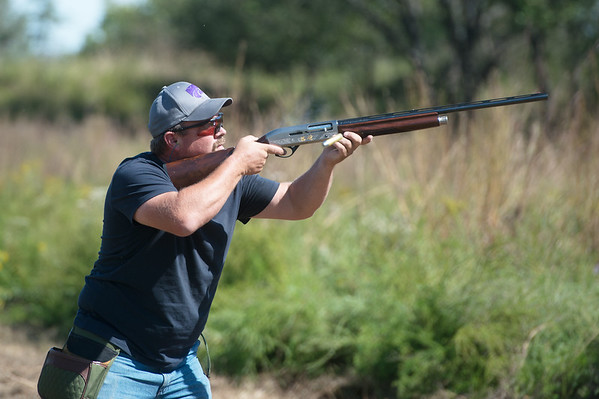 Globe/Roger Nomer<br /> Jim Michael, McCune, shoots at a clay target on Friday at Claythorne Lodge.