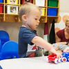 Globe/Roger Nomer<br /> James White, 2, plays with toy cars on Wednesday at the Early Childhood Center in Joplin.