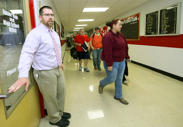 Miller High School first-year principal Dennis Kimzey watches as students pass through the halls between classes. Kimzey said the four-day week at Miller is a big part of why he took the job. Kimzey, who has three children ages five and under, said it allows him to spend a little extra time with his own children.<br /> Globe | Laurie Sisk