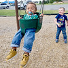 Big brother Jayden Conlee, 4, provides the muscle for baby brother Kihre'e Taylor, 1, as they enjoy mild temperatures at Cunningham Park on Wednesday.<br /> Globe | Laurie Sisk