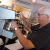 Globe/Roger Nomer<br /> Danny Anderson, co-owner of Streetcar Station Coffee Shop in Galena, makes a drink on Tuesday.