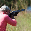Globe/Roger Nomer<br /> Randy Mill, Joplin, shoots at a clay target on Friday at Claythorne Lodge.