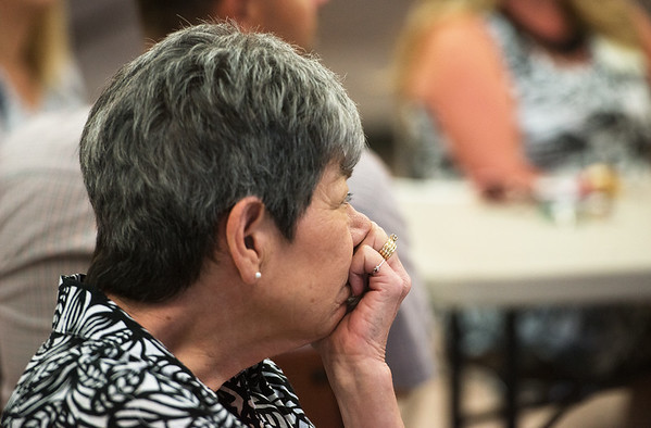 """Globe/Roger Nomer<br /> Linda Fracek listens to the story of a letter from a survivor of the Sept. 11, 2001, attack during a presentation on Thursday at the Grove Community Center. Fracek is the assistant director of the play """"If All the Sky Were Paper"""" being produced in Grove."""