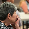 "Globe/Roger Nomer<br /> Linda Fracek listens to the story of a letter from a survivor of the Sept. 11, 2001, attack during a presentation on Thursday at the Grove Community Center. Fracek is the assistant director of the play ""If All the Sky Were Paper"" being produced in Grove."