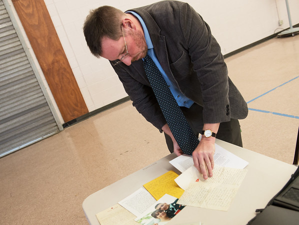 Globe/Roger Nomer<br /> Andrew Carroll arranges letters for display on Thursday before a presentation at Grove Community Center.