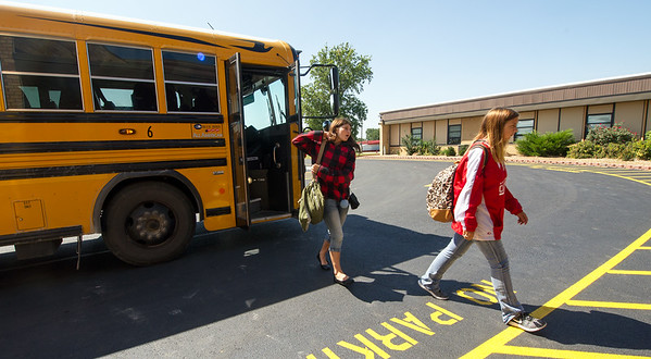 Students exit a bus from their Vo-Tech classes on Wednesday at Miller High School. Though most students attend a four-day a week schedule, Vo-Tech students still attend five days.<br /> Globe | Laurie Sisk