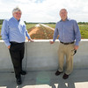 From the left: Jeff Hawkins, executive director of the Northwest Arkansas Regional Planning Commission and Tim Conklin, transportation program manager for NWARPC, stand Thursday on a bridge near Bentonville on County Road 34, where a continuation of the I-49 Bypass project is planned.<br /> Globe | Laurie Sisk