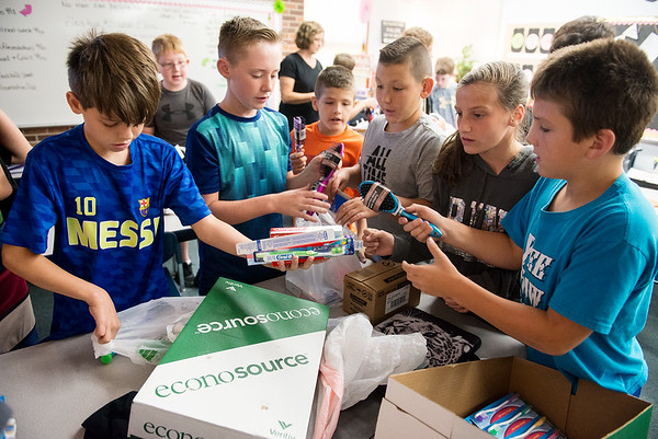 Globe/Roger Nomer<br /> Riverton Middle School sixth graders sort donations to Texas hurricane victims on Thursday at the school.