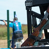 Globe/Roger Nomer<br /> Competitors use shotguns to shoot at clay targets on Friday at Claythorne Lodge.