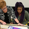 Globe/Roger Nomer<br /> Denise Bertoncino, program coordinator for the interior design, helps Briona Amos, a Pittsburg State senior from Kansas City, Kan., with a perspective project on Monday at Pittsburg State's Kansas Technology Center.