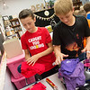 Globe/Roger Nomer<br /> Ryder Phillips, left, and Loch North, Riverton Middle School sixth graders, sort clothing for donations to Texas hurricane victims on Thursday at the school.