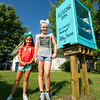 From the left: Sisters Jacee Divine, 7 and Jenna Schulz, 10 stand beside the Blessing Box the family built at their Carterville home. The box is dedicated to the memory of their grandmother, Kathy Divine and was made from one of her old dressers.<br /> Globe | Laurie Sisk