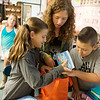 Globe/Roger Nomer<br /> Alivia Parker, left, Jacklynn Kufahl and Ryder Goodman, sixth graders at Riverton Middle School, collect books for donations to Texas hurricane victims on Thursday at the school.
