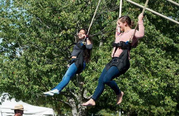 Globe/Roger Nomer<br /> Hania Henandez, a Missouri Southern freshman from Carthage, left, and Sarah Forman, a freshman from Carthage, jump with bungie cords during an event on Friday at the annual MSSU Homecoming Picnic.