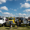 Globe/Roger Nomer<br /> Visitors to the Big Truck Show on Friday look at a line of big rig trucks.