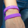 Danita Tamilio displays the recovery awareness bracelets she and other recovering addicts handed out at Third Thursday. Tamilio has been clean and sober two-years while battling an opiate addiction.<br /> Globe | Laurie Sisk