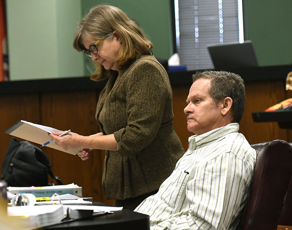 Todd Greathouse, center, sits in his chair as Public Defender Kathleen Byrnes reviews her notes on Tuesday at the Jasper County Circuit Court. Greathouse is on trial for the first-degree murder of 61-year-old Willanna Dunn.<br /> Globe | Laurie Sisk