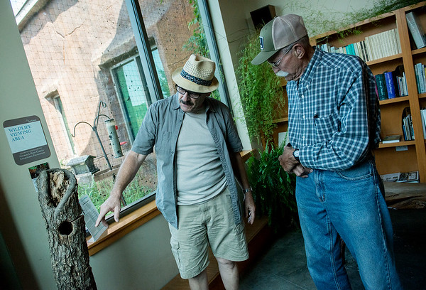 Globe/Roger Nomer<br /> Don White, left, Mission Viejo, Calif., looks at exhibits with his uncle Dean Ogden, Tipton Ford, on Friday at the Wildcat Glades Conservation & Audubon Center.