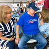 Longtime local physician, Dr. Donald Patterson, visits with his daughter-in-law, Deborah Patterson, of Roanoake, Va. (left) and His eldest granddaughter, Heather Patterson, of San Francisco during the Alpha AirFest 2017 on Saturday at the Joplin Regional Airport.<br /> Globe | Laurie Sisk