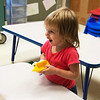 Globe/Roger Nomer<br /> Maggie McGinnis, 1, plays with toy cars on Wednesday at the Early Childhood Center in Joplin.