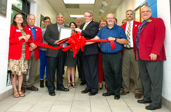 Representatives from the Joplin Family YMCA and the Joplin Area Chamber of Commerce loook to the future as they gather Wednesday for a rededication of the YMCA. Pictured center left if YMCA CEO Cookie Estrada.<br /> Globe | Laurie Sisk