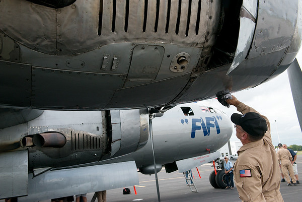 "Steve Zimmerman, aircraft commander, cleans up ""Fifi"" after its flight into Joplin on Monday.<br /> Globe 