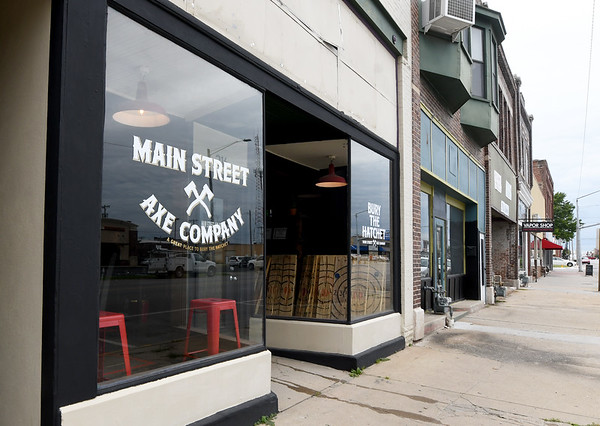 Main Street Axe Company, where axe throwers can test their skills or join leagues sits in downtown Pittsburg on Friday.<br /> Globe | Laurie Sisk