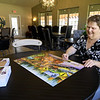 Redwood Gardens resident Darlene Nodine takes advantage of one of two large community buildings at Redwood Gardens on Wednesday. Nodine, who was the first resident to move into the development on May 1, said her favorite aspects of living in the senior community are no taxes, no mowing and no maintenance.<br /> Globe | Laurie Sisk
