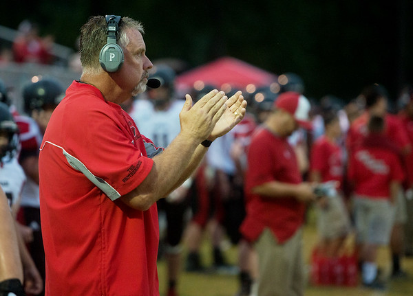 Lamar head coach Scott Bailey claps for his team before Friday's game against Seneca.<br /> Globe | Roger Nomer