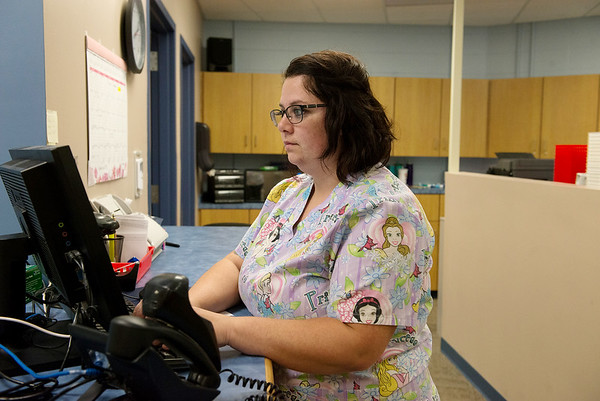 Lauren Housechief, certified technician, works the Access Family Care pharmacy on Wednesday.<br /> Globe | Roger Nomer