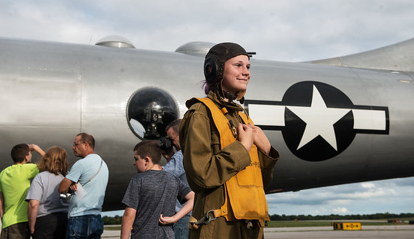 """Wearing a WWII Women Airforce Service Pilots uniform, Ella Denno, 13, looks over the B-29 Bomber """"Fifi"""" on Monday at the Joplin Regional Airport.<br /> Globe 