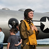 "Wearing a WWII Women Airforce Service Pilots uniform, Ella Denno, 13, looks over the B-29 Bomber ""Fifi"" on Monday at the Joplin Regional Airport.<br /> Globe 