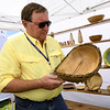 Craftsman Mike Ilkiw, of Bowls for Breasts, discusses the wood turning involve in the creation of this unique bowl during the Joplin Arts Fest on Saturday at Mercy Park. Ilkiw donates a generous portion of his proceeds to the Breast Cancer Foundation of the Ozarks. Ilkiw, of Springfield, lost his first wife to breast cancer in 2011.<br /> Globe | Laurie Sisk