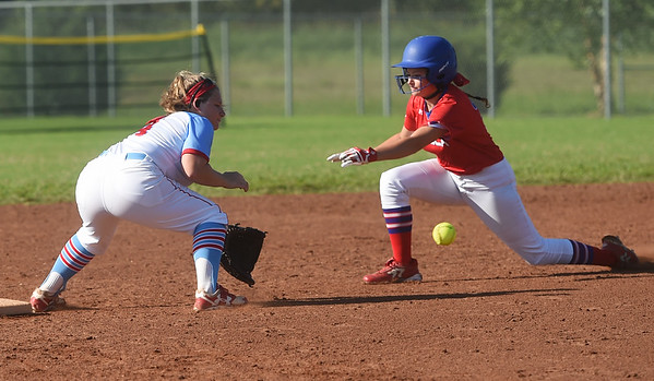 Webb City's Fallon Holcomb gets the throw to tag out Seneca's Gracie Heckart during Saturday's Paige Neal/Christina Freeman Softball Tournament at the Joplin Athletic Complex.<br /> Globe   Roger Nomer